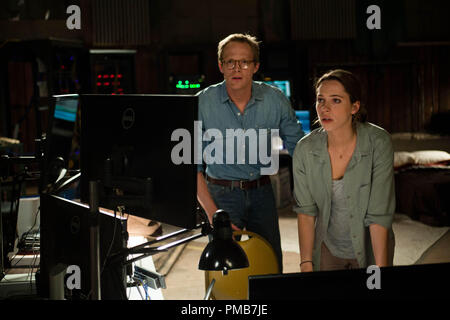(L-r) PAUL BETTANY as Max Waters and REBECCA HALL as Evelyn Caster in Alcon Entertainment's sci-fi thriller 'TRANSCENDENCE,' a Warner Bros. Pictures release. - Stock Photo