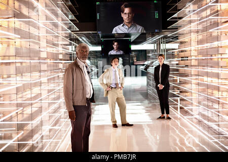 (L-r) MORGAN FREEMAN as Joseph Tagger, CILLIAN MURPHY as Agent Buchanan, JOHNNY DEPP as Will Caster (on monitors), and REBECCA HALL as Evelyn Caster in Alcon Entertainment's sci-fi thriller 'TRANSCENDENCE,' a Warner Bros. Pictures release. - Stock Photo