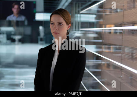 (L-r) JOHNNY DEPP as Will Caster (on monitor) and REBECCA HALL as Evelyn Caster in Alcon Entertainment's sci-fi thriller 'TRANSCENDENCE,' a Warner Bros. Pictures release. - Stock Photo