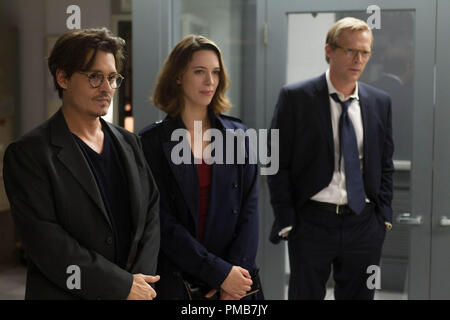 (L-r) JOHNNY DEPP as Will Caster, REBECCA HALL as Evelyn Caster and PAUL BETTANY as Max Waters in Alcon Entertainment's sci-fi thriller 'TRANSCENDENCE,' a Warner Bros. Pictures release. - Stock Photo