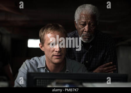 (L-r) PAUL BETTANY as Max Waters and MORGAN FREEMAN as Joseph Tagger in Alcon Entertainment's sci-fi thriller 'TRANSCENDENCE,' a Warner Bros. Pictures release. - Stock Photo
