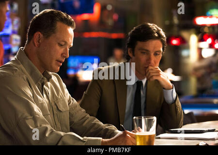 (L-r) COLE HAUSER as Colonel Stevens and PAUL BETTANY as Max Waters in Alcon Entertainment's sci-fi thriller 'TRANSCENDENCE,' a Warner Bros. Pictures release. - Stock Photo