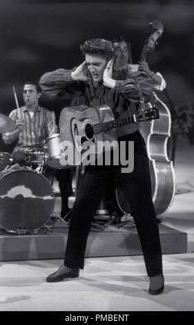 Elvis Presley performing during his first appearance on 'The Ed Sullivan Show,' September 9, 1956 in Los Angeles, CA CBS  File Reference # 33371 853THA - Stock Photo