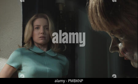 L) The Annabelle doll with ANNABELLE WALLIS as Mia in New