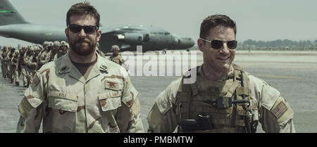 (L-r) BRADLEY COOPER as Chris Kyle and SAM JAEGER as Navy Seal Lt. Martin in Warner Bros. Pictures' and Village Roadshow Pictures' drama 'AMERICAN SNIPER,' distributed worldwide by Warner Bros. Pictures and in select territories by Village Roadshow Pictures. - Stock Photo