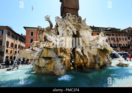 Fountain of the four Rivers with Egyptian obelisk, in the middle of Piazza Navona - Stock Photo