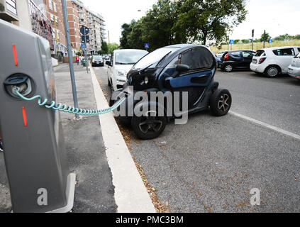 A Renault Twizy electric car charging its battery. - Stock Photo