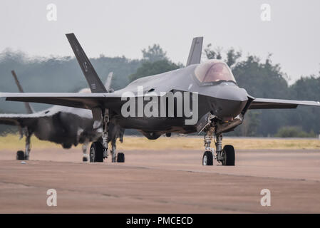 US Air Force Lockheed Martin F-35A Lightning II at the Royal International Air Tattoo, RIAT, RAF Fairford. Taxiing in pair - Stock Photo