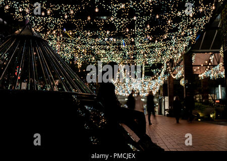 AUCKLAND, NEW ZEALAND - SEPTEMBER 14 2018; Silhouettes and blurry people moving about  in urban background image in Auckland's Britomart area - Stock Photo