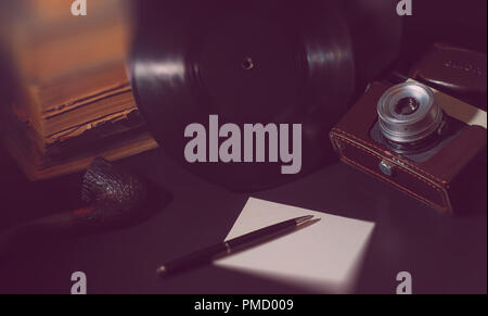 Vinyl plate and retro camera - Stock Photo