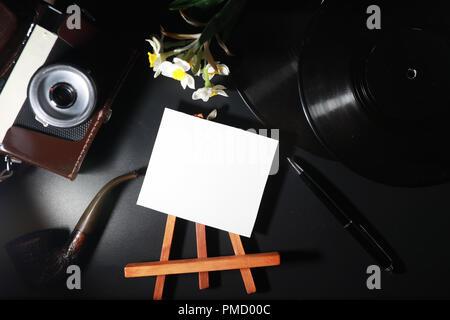 Vinyl plate and retro camera - Stock Photo