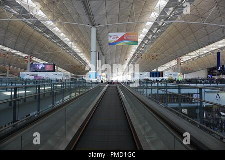 Moving walkway to departure gates at Hong Kong International Airport, Hong Kong, China - February 16 2018 - Stock Photo