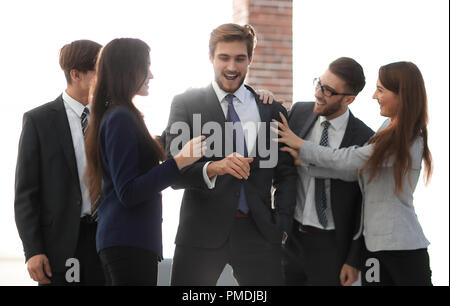 Portrait of a professional business team celebrate their victory - Stock Photo