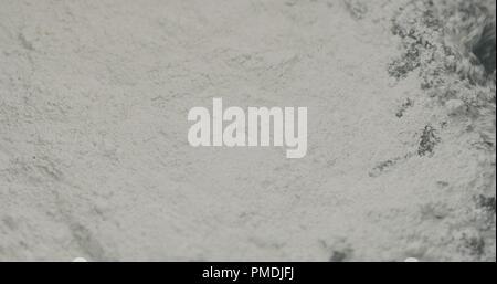 mixing hardener in micro concrete plaster - Stock Photo