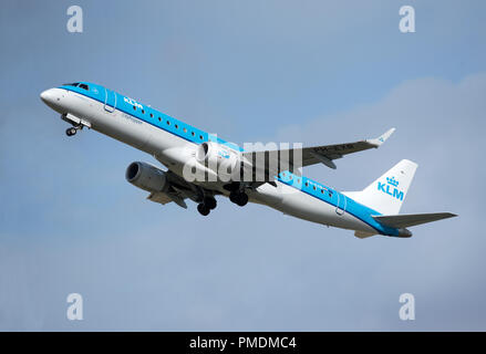KLM City Hopper from Amsterdam at Inverness airport on it's daily scheduled trip over the North Sea. - Stock Photo
