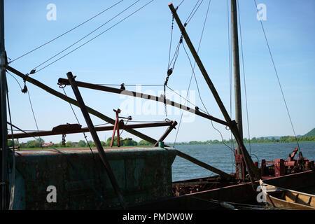 One of the last big professional fishermen ships on the Danube near Regensburg in Germany - Stock Photo