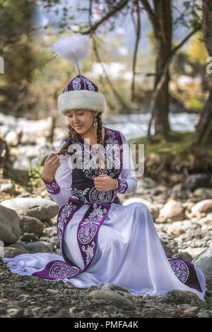 Lake Issyk-Kul, Kurgyzstan, 6th September 2018: young kyrgyz ladies in a nature - Stock Photo