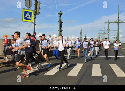 Participants of 'Cross of Nation - 2018' mass running event in St. Petersburg. Running Day - Stock Photo