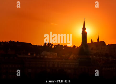 Back-lit Skyline of Budapest at Sunset, with the Tower of Matthias Church - Stock Photo