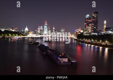 London South Bank by night using long exposures to create light trails - Stock Photo