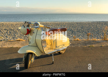 Lambretta Scooter, moped, on the beach front, Th Knap, near Barry Island, Barry, Wales, UK. - Stock Photo