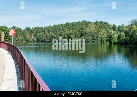 Lake Robertville is an artificial lake near the city of Malmedy in Belgium in Europe. The water volume is 8,000,000 m3 and the area is 0,62 km2. The lake is located in the High Fens park. The dam on the river Warche was built in 1928. - Stock Photo
