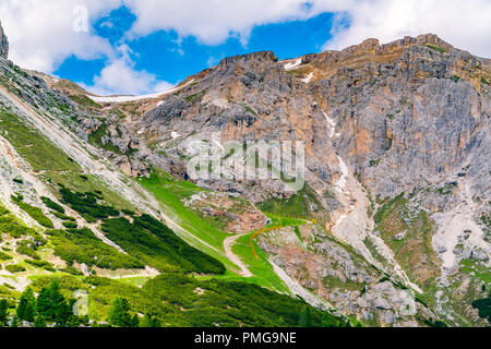 View of trekking route in the Dolomites at Falzarego Pass in the Province of Belluno in Italy - Stock Photo