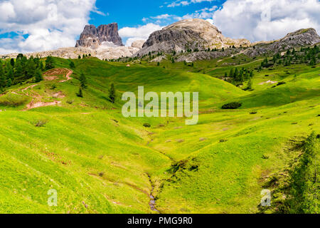 View of Mount Averau in Nuvolau group with the hilly of yellow flowers from the Falzarego Pass at Cortina d´Ampezzo in Italy - Stock Photo