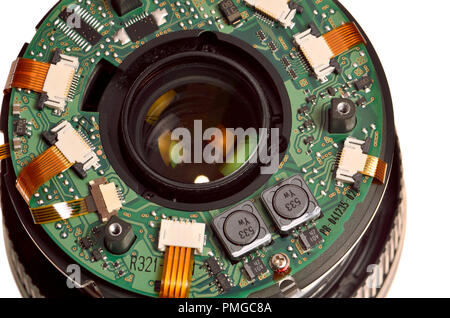 Inside a photographic lens - part of the electronics and rear element of a Nikon 70-300 lens - Stock Photo
