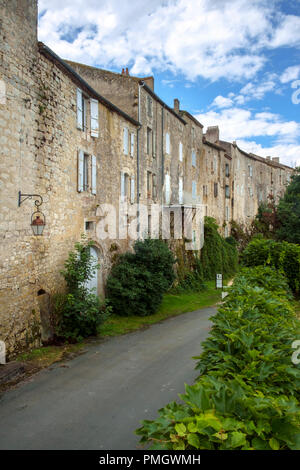 The massive walls of historic homes in the 'bastide' town of Tournon d'Agenais, Lot et Garonne, France - Stock Photo