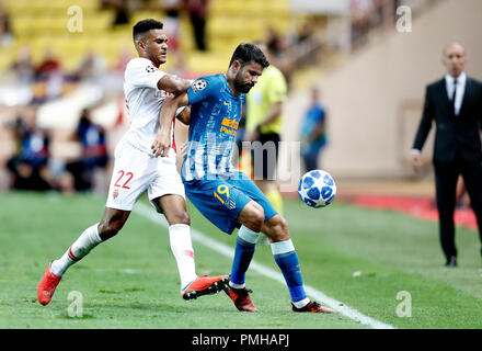 Fontvieille. 18th Sep, 2018. Jordi Mboula (L) of As Monaco vies with Diego Costa of Atletico Madrid during the UEFA Champions League group A match between As Monaco and Atletico Madrid in Fontvieille, Monaco on Sept. 18, 2018. Atletico Madrid won 2-1. Credit: Miguel Almaro/Xinhua/Alamy Live News - Stock Photo