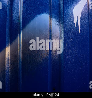 painted metallic blue color is sprayed with silver paint. Element of design. Background and surface. - Stock Photo
