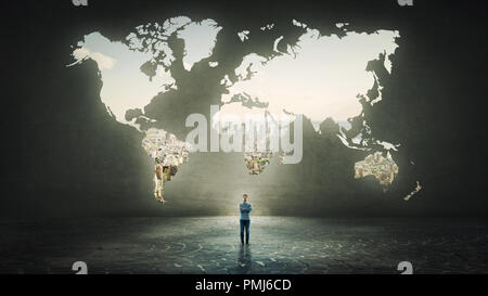 Confident businessman with crossed hands standing alone in front of the world map hole as a window shaped in a concrete wall with a view to the city. - Stock Photo