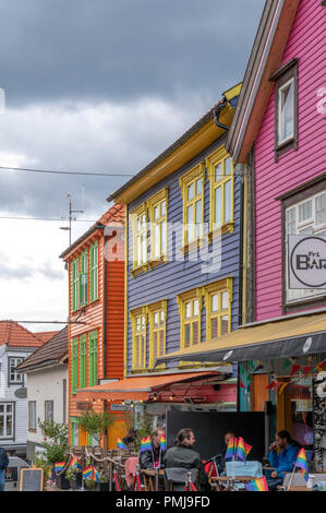 Colourful shops, bars, cafes and restaurants in this popular busy street close to where the huge cruise ships land. So often visited by tourists - Stock Photo