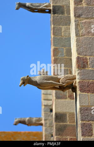 Close-up on stone gargoyles carved on the facade of Saint Vincent Cathedral inside the walled city of Saint Malo, Brittany, France - Stock Photo