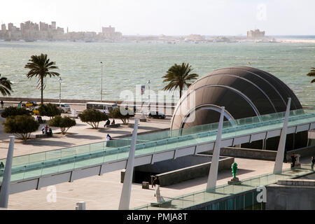 View of the embankment of the city and part of the modern library building Alexandrina in Alexandria, Egypt - Stock Photo
