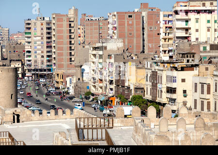 View of the city district and El Moez street from the top of the minaret of al-Hakim Mosque of Cairo, Egypt - Stock Photo