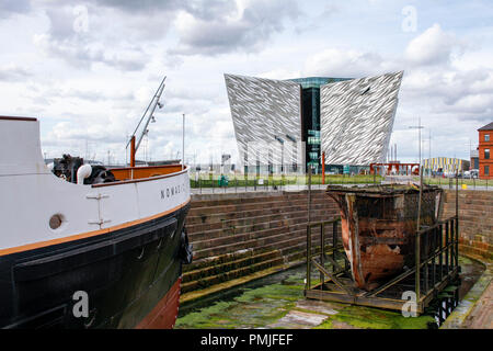 SS Nomadic, the last remaining ship of the White Star Line and the Titanic Belfast museum in the Titanic Quarter of Belfast, Northern Ireland. - Stock Photo