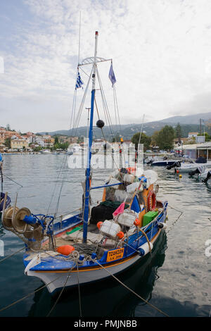 Local fishing boat in Kassiopi harbour, Corfu, Greece - Stock Photo
