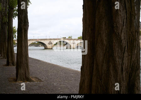 Pedestrian walkway along the Seine river in Paris, France - Stock Photo