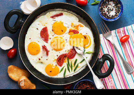 Fried eggs with cherry tomatoes in a pan. Fresh and hearty Breakfast. The view from the top - Stock Photo