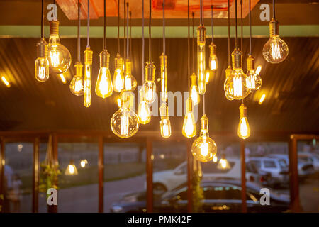 Many of Decorative light lamp bulb glowing on the ceiling - Cool light - gold tone - Stock Photo