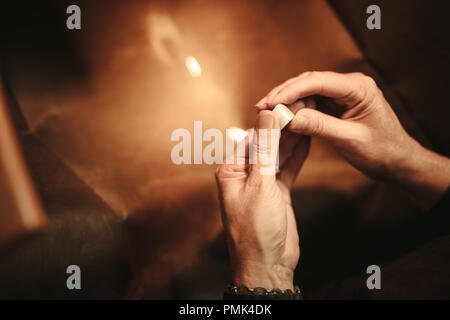 Hands of female jeweler making ring at her workbench. Woman jewelry maker hands crafting new jewelry in workshop. Close up shot of female goldsmith ha - Stock Photo
