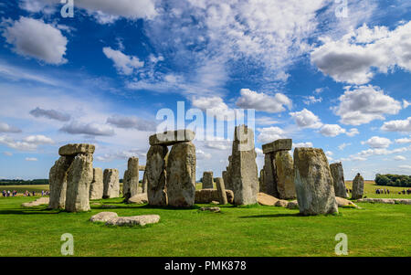 Stonehenge, against a bright blue sky with light clouds - Stock Photo