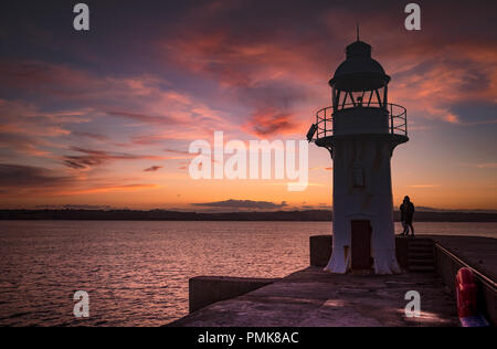 Brixham Lighthouse at dusk - Stock Photo