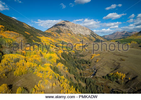Intense fall color below Gothic Mountain along the East River near Crested Butte, Colorado. - Stock Photo