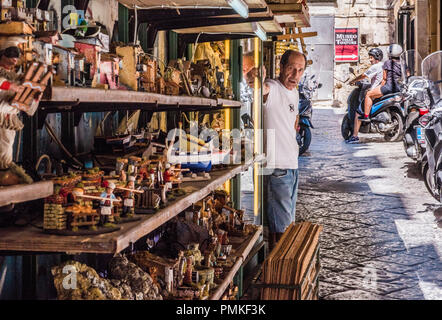 Portrait of a man, standing outside his workshop, in the oldest area of the city of Naples, Italy, Europe - Stock Photo