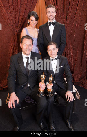 Winning the category Best Animated Short Film for work on 'The Lost Thing', Oscar -winner Shaun Tan and Andrew Ruhemann pose backstage with presenters Justin Timberlake and Mila Kunis, during the live ABC Televison Network broadcast of the 83rd Annual Academy Awards from the Kodak Theatre in Hollywood, CA Sunday, February 27, 2011.  File Reference # 30871_403  For Editorial Use Only -  All Rights Reserved - Stock Photo