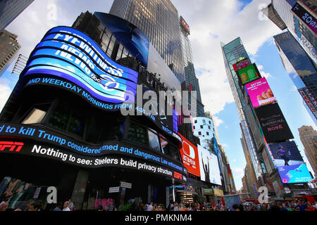 New York, USA – August 24, 2018: Crowded with many people walking Times Square with huge number of LED signs, is a symbol of New York City in Manhatta
