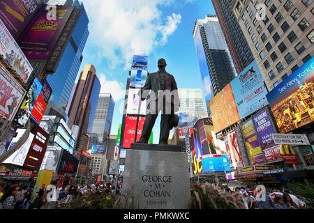 New York, USA – August 24, 2018: Statue of songwriter and performer George Cohan and many people on Times Square at 7th Avenue and Broadway in Midtown - Stock Photo